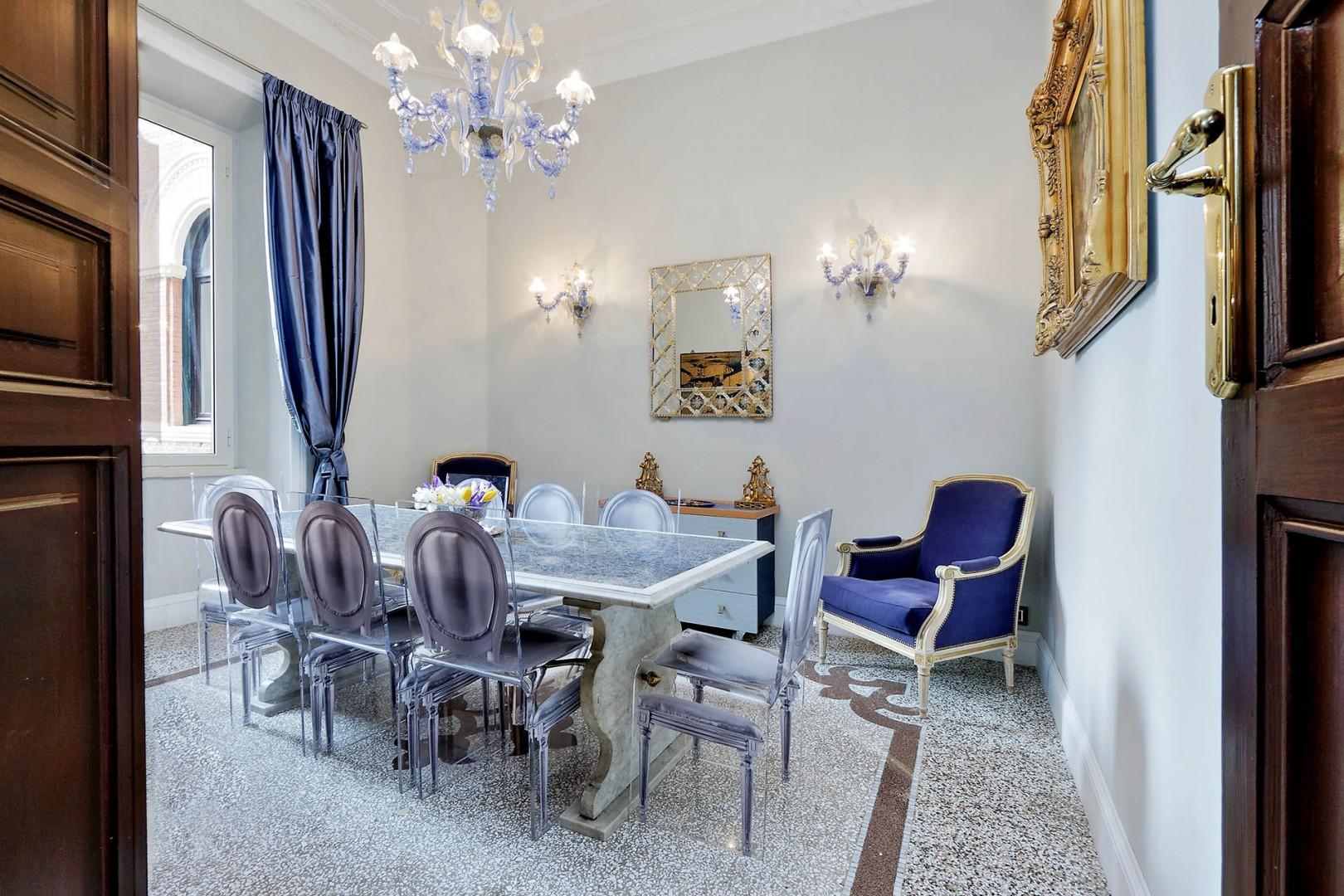 The dining room is stunning in dramatic blues.