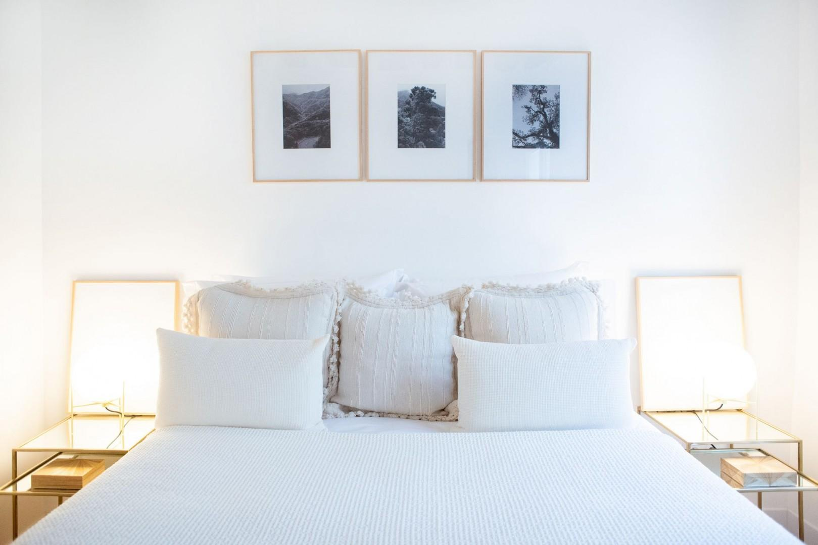 Enjoy the large bed with luxurious linens and soft reading light.