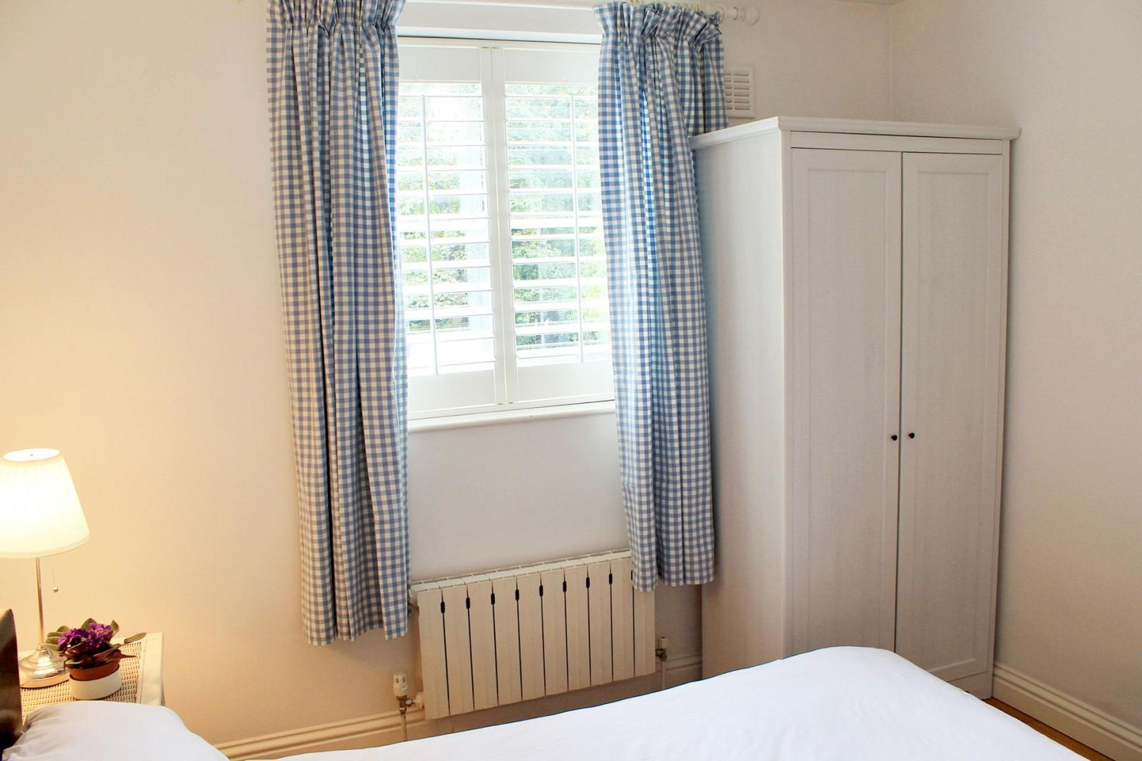 Pack away your belongings in the first bedroom cupboard