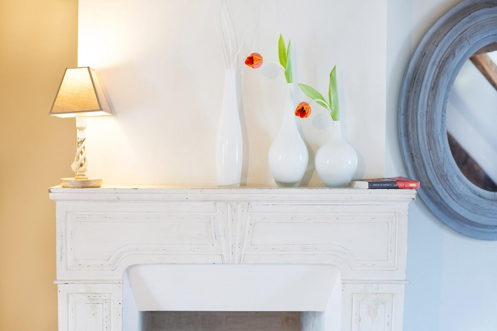 This delightful room also has a feature mantlepiece!