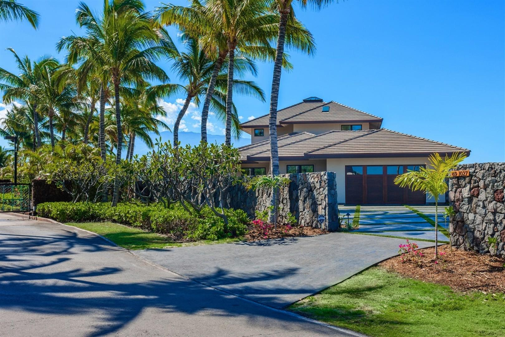 View of the driveway and home from the street within the gated community.