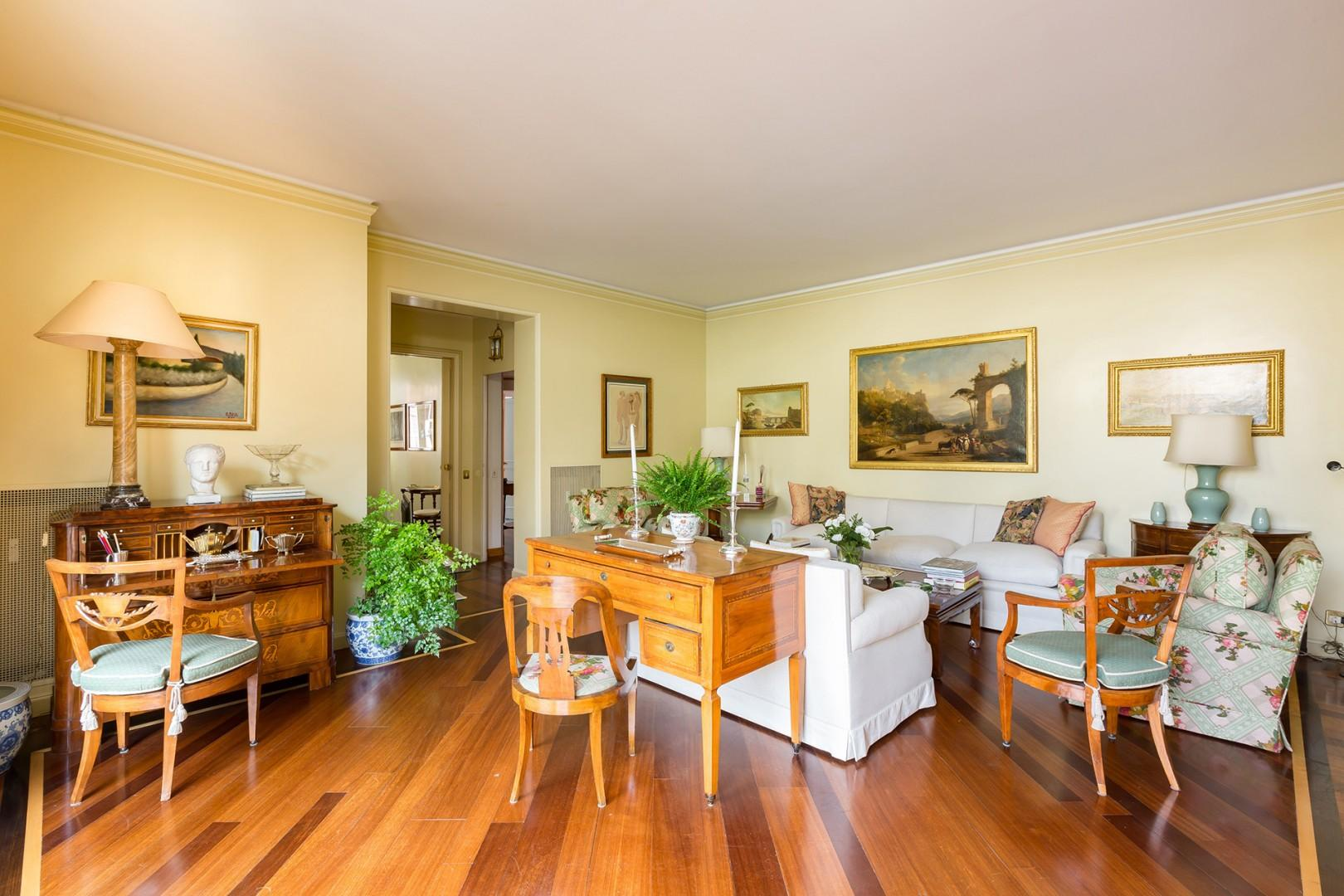 A beautiful antique desk transitions the living room to the terrace.