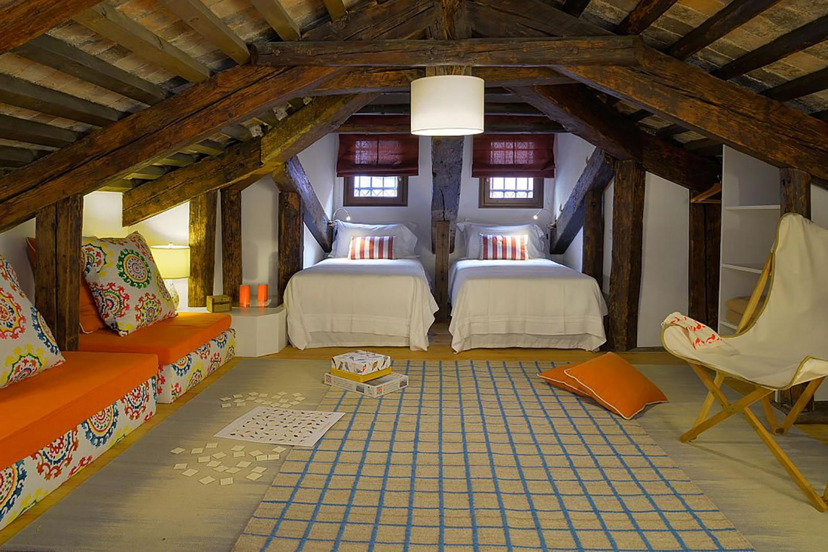 Attic bedroom. Bright highlights will appeal to children who can best navigate the low ceiling.