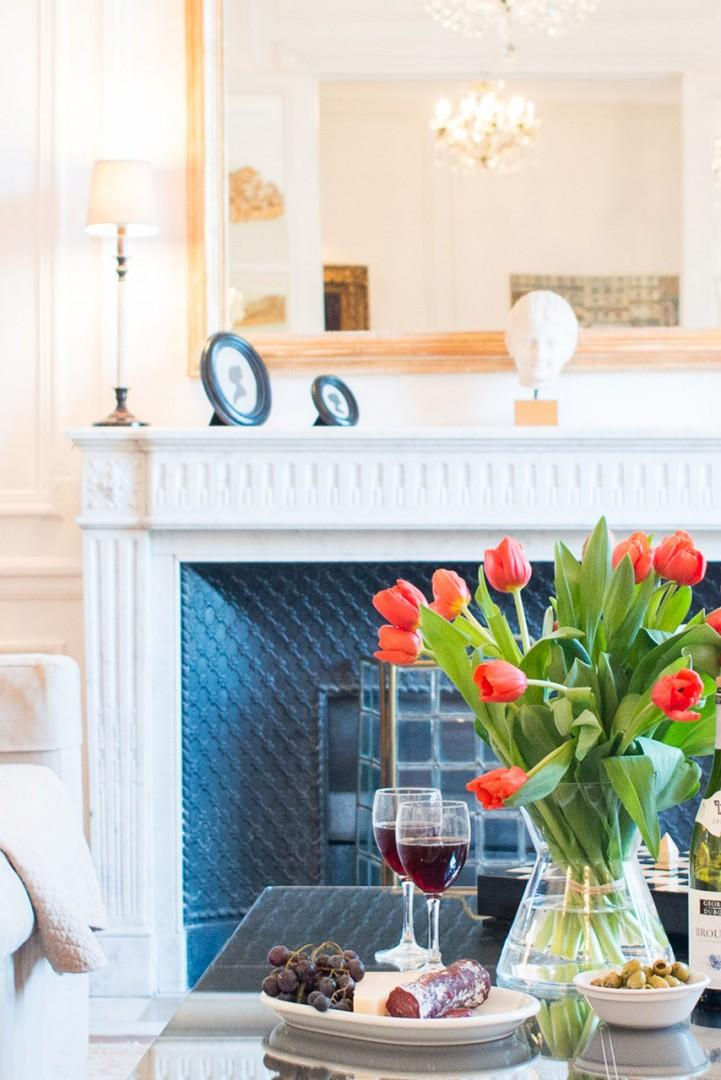 The marble fireplace is the focal point for the living room.