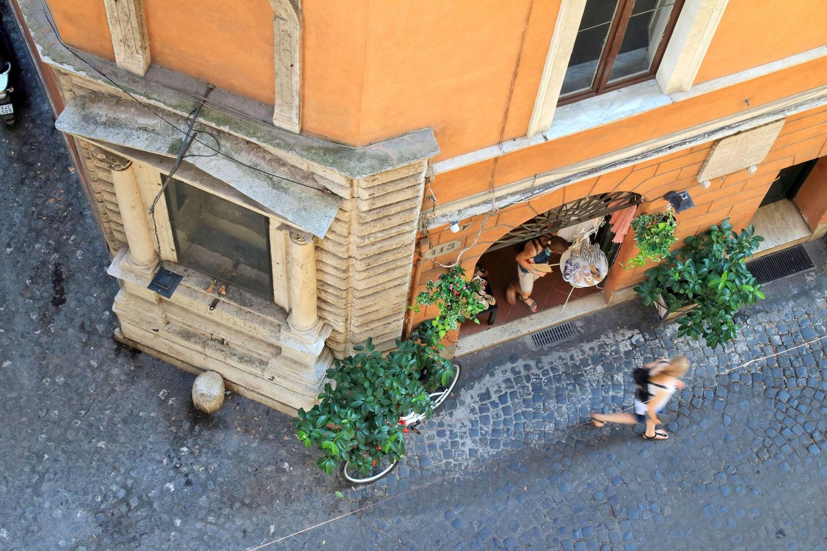 View from apartment onto small piazza offering a slice of Roman life.