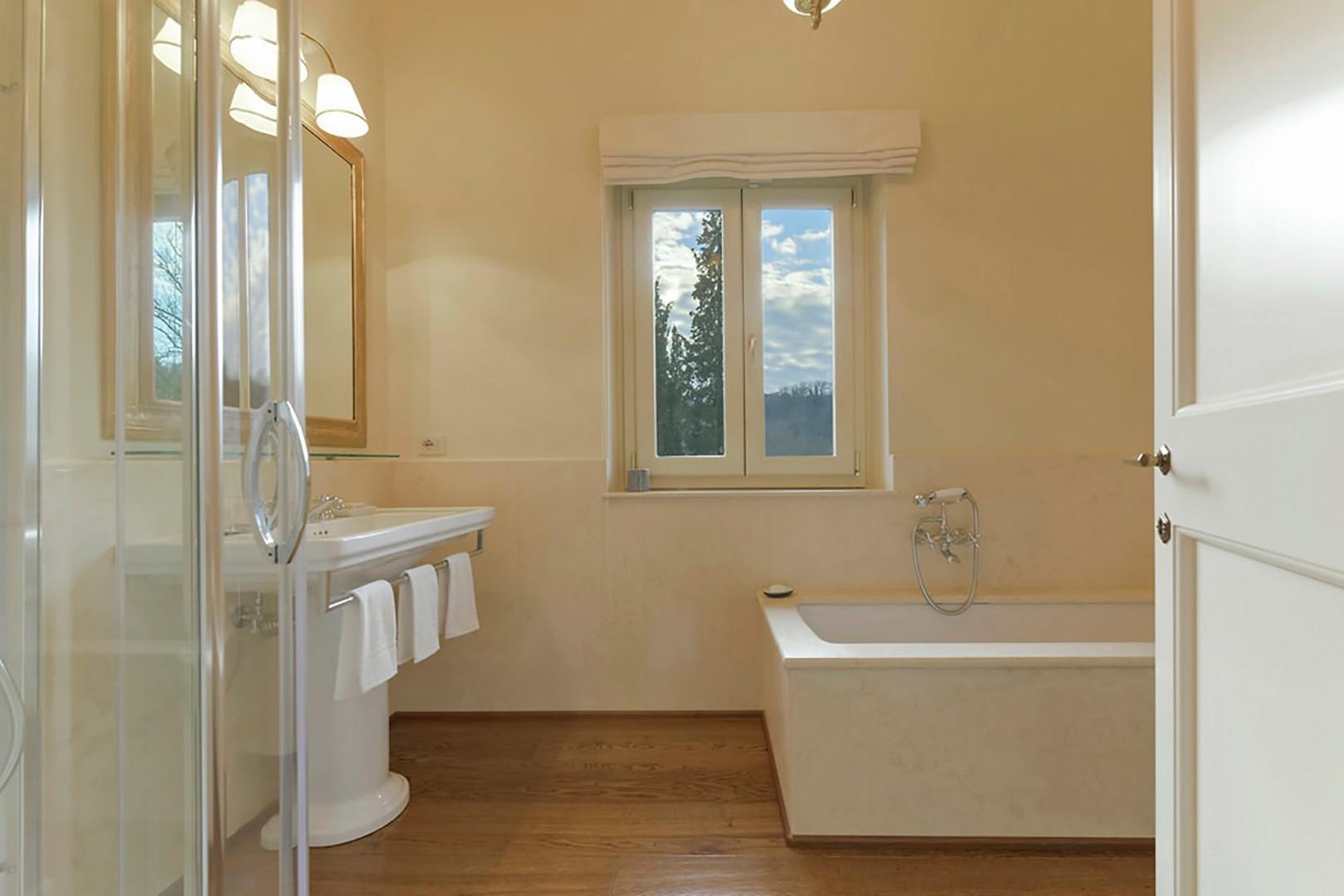 En suite bathroom to bedroom 1 has both a shower and bathtub.