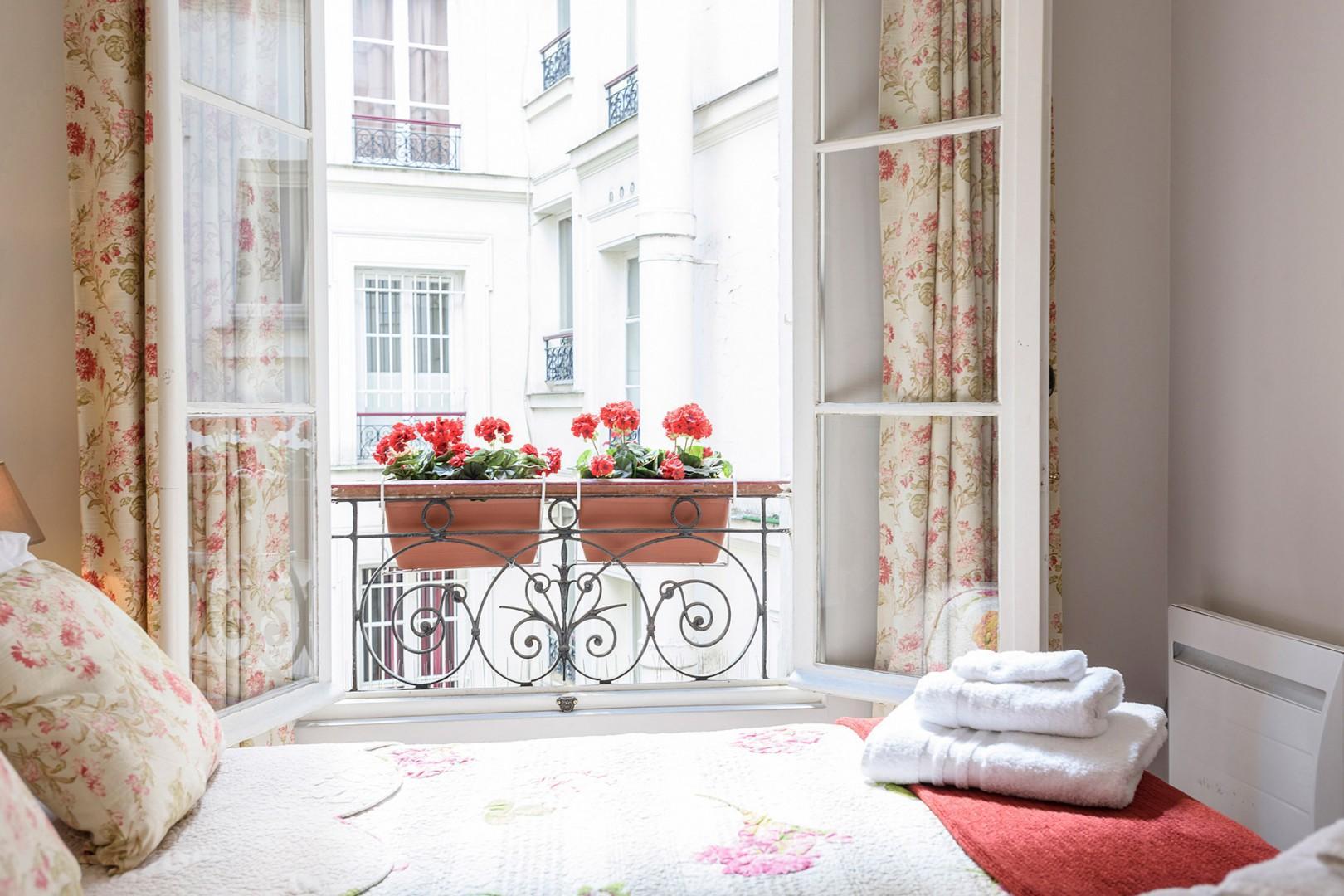 This quiet bedroom overlooks a courtyard.
