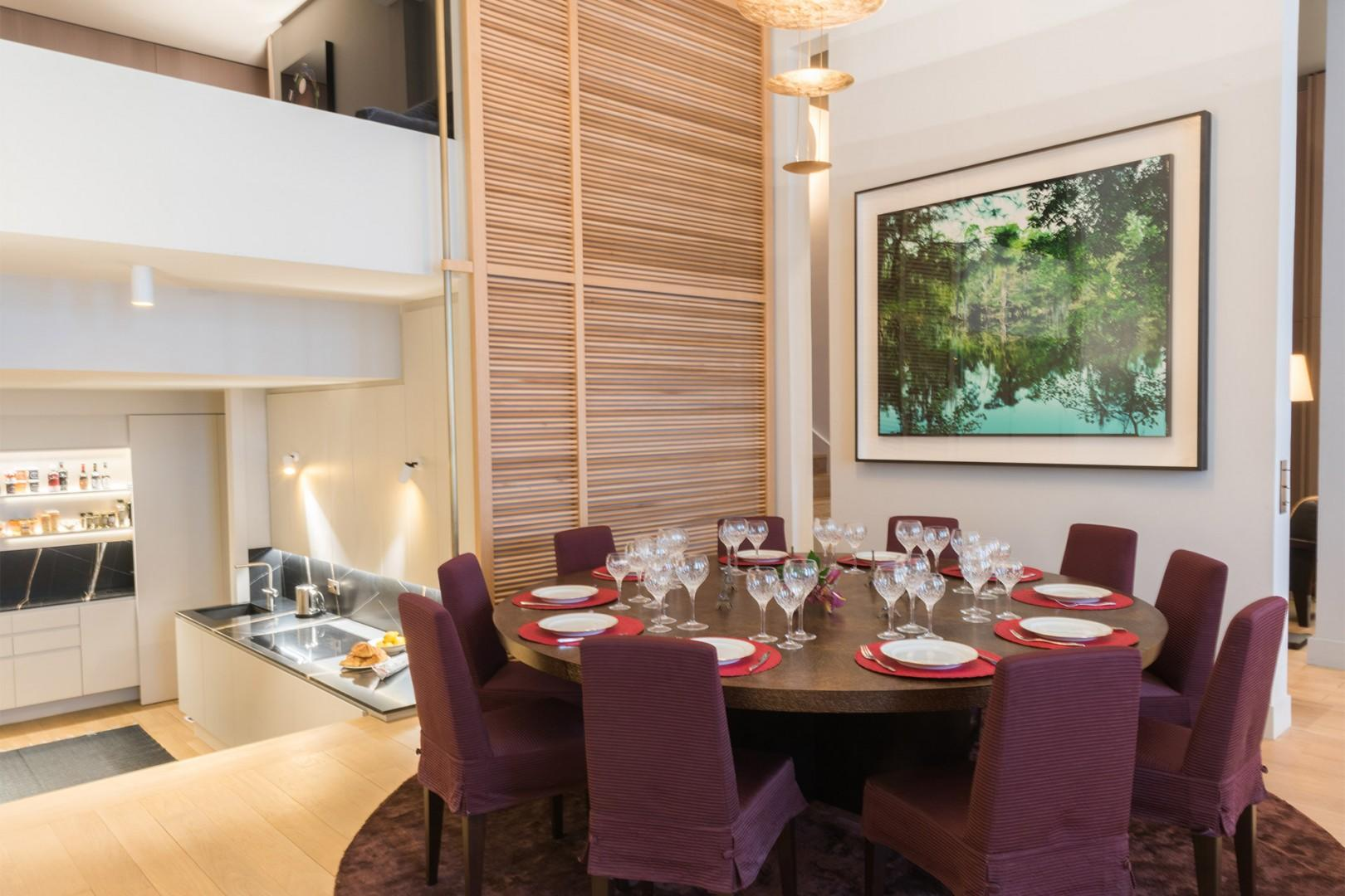 The centerpiece of the room is a grand dining table that seats up to 10 people.