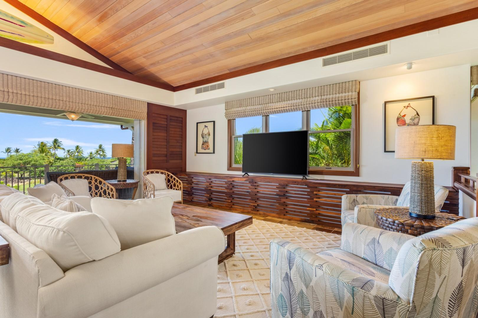 Closer angle on chic and comfortable living area seating with flat screen television.