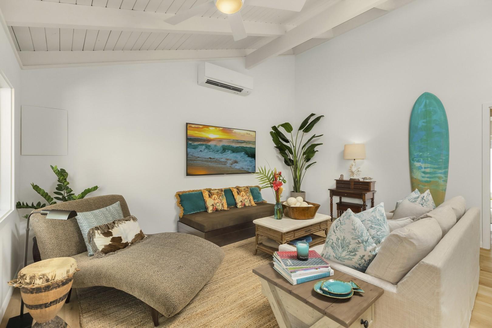Living room features, stylish furnishings, Split A/C and large flatscreen TV