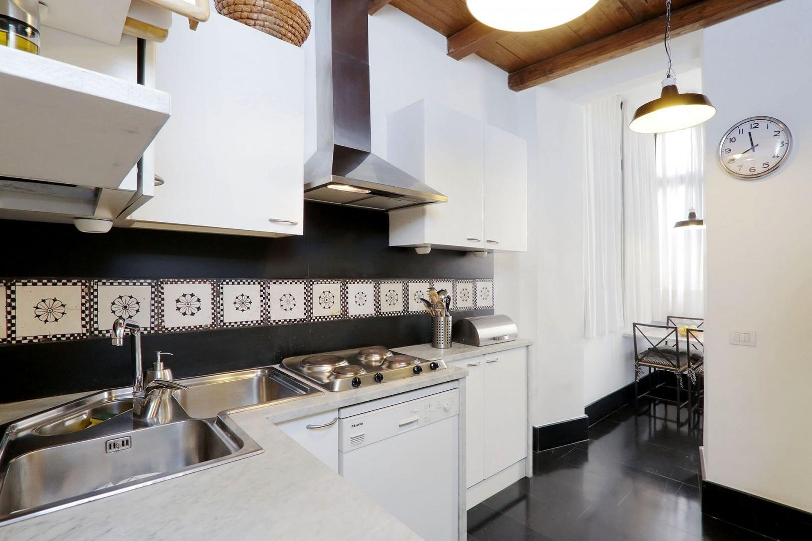 This full and separate kitchen will support simple or elaborate cooking.