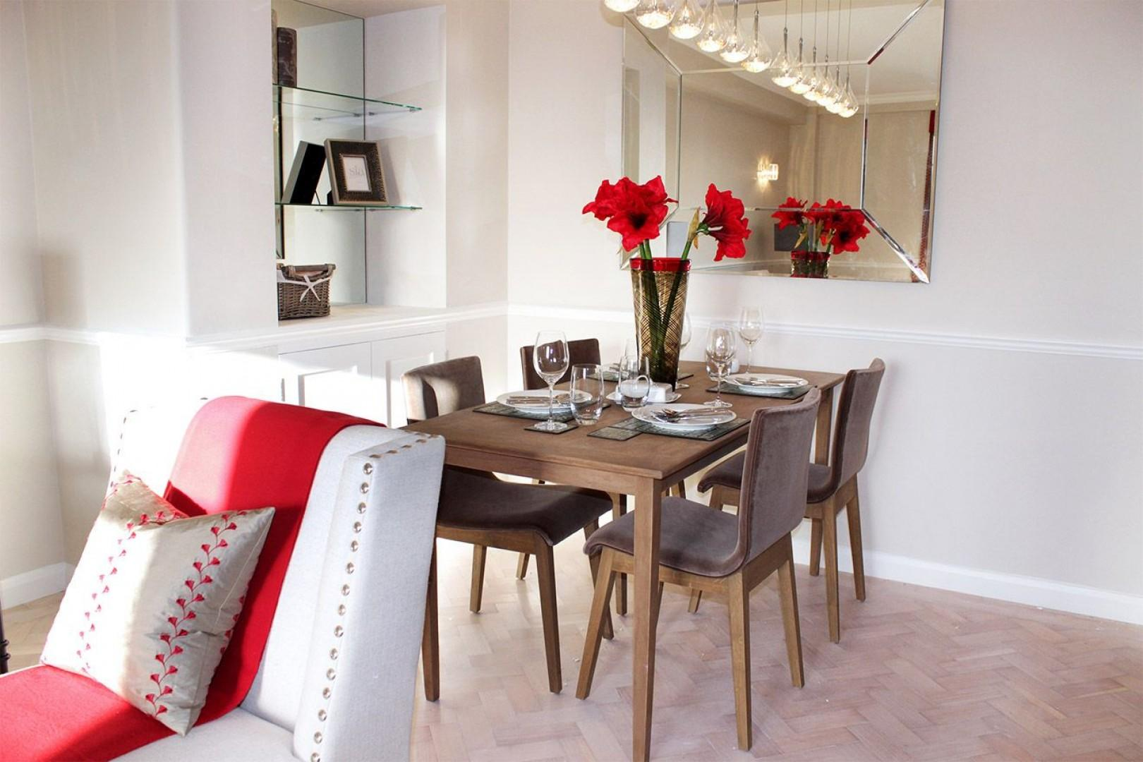 Dining area with wooden table seats four comfortably