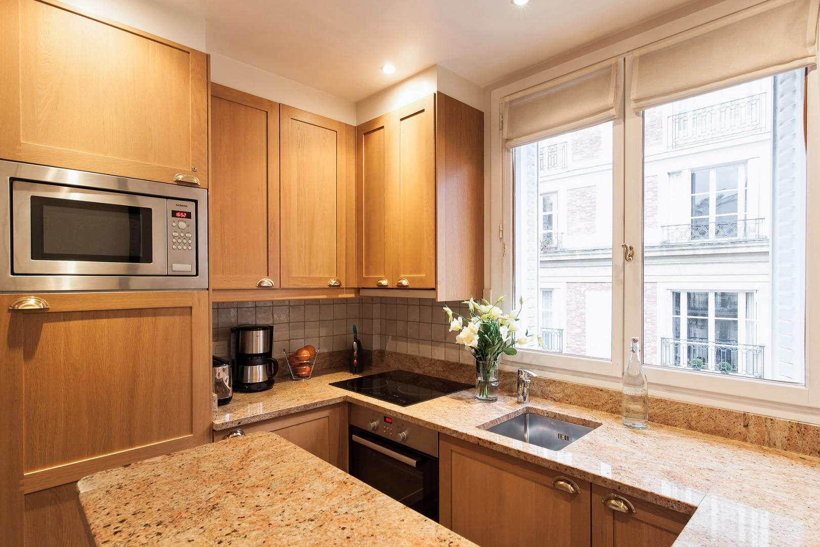 The kitchen is fully-equipped with quality appliances.