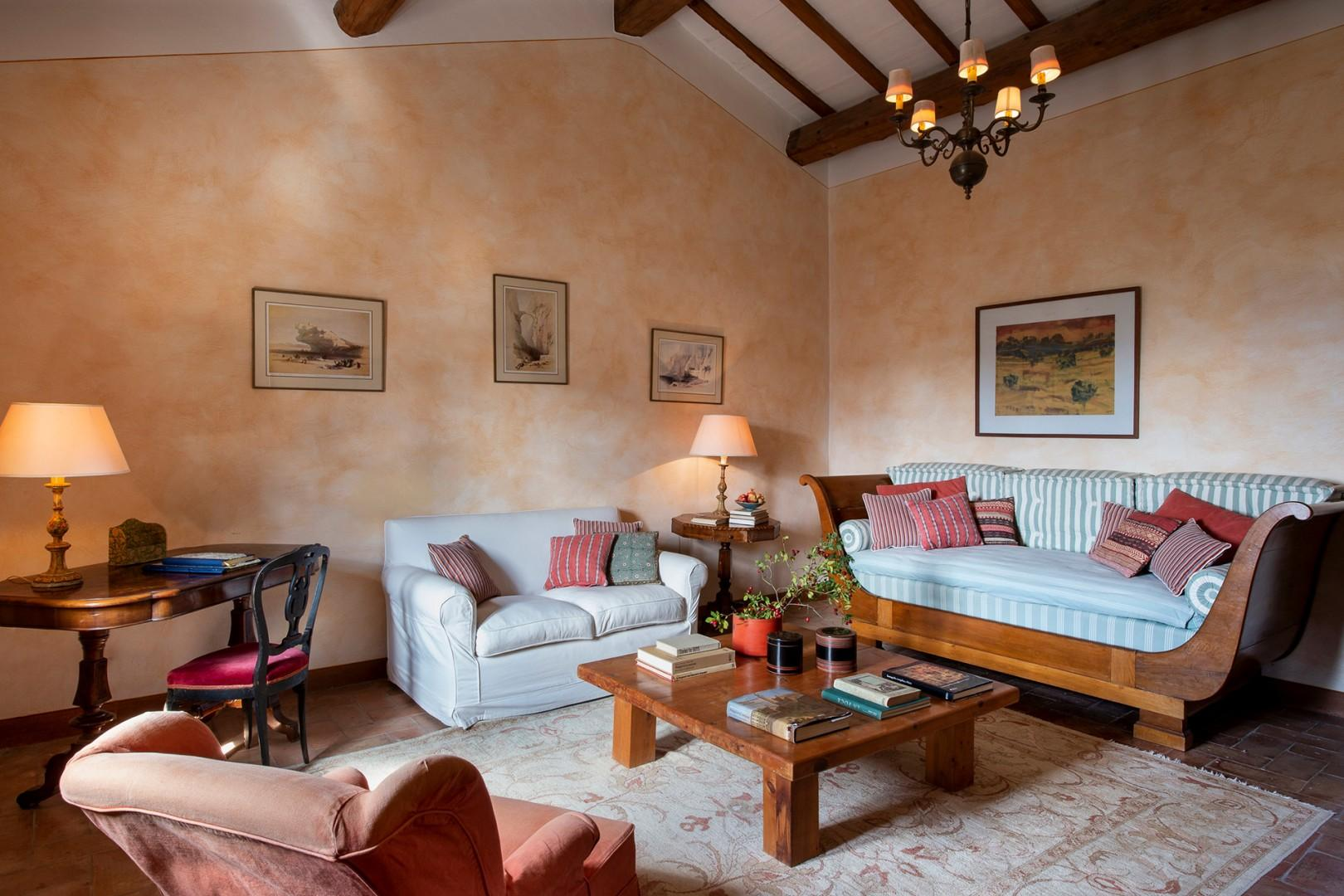 Comfortably furnished living room of Vespa has and antique empire sofa bed.