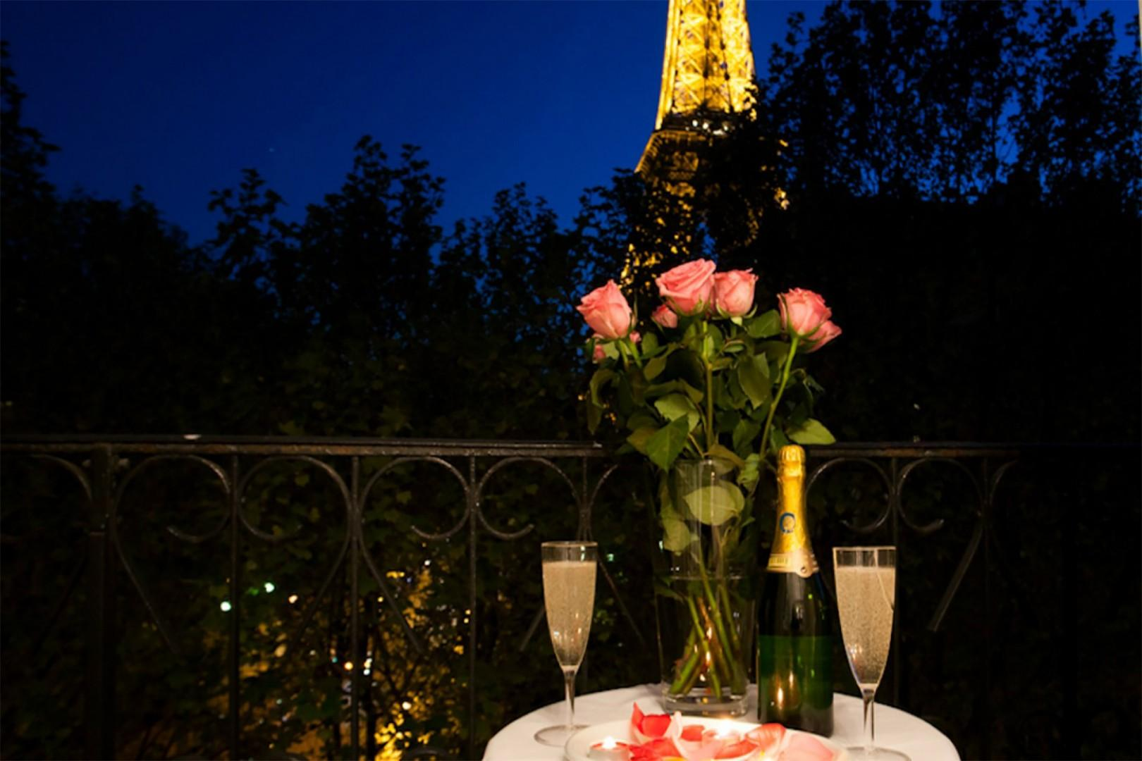 Enjoy cozy evenings on the balcony with fantastic Eiffel Tower views.