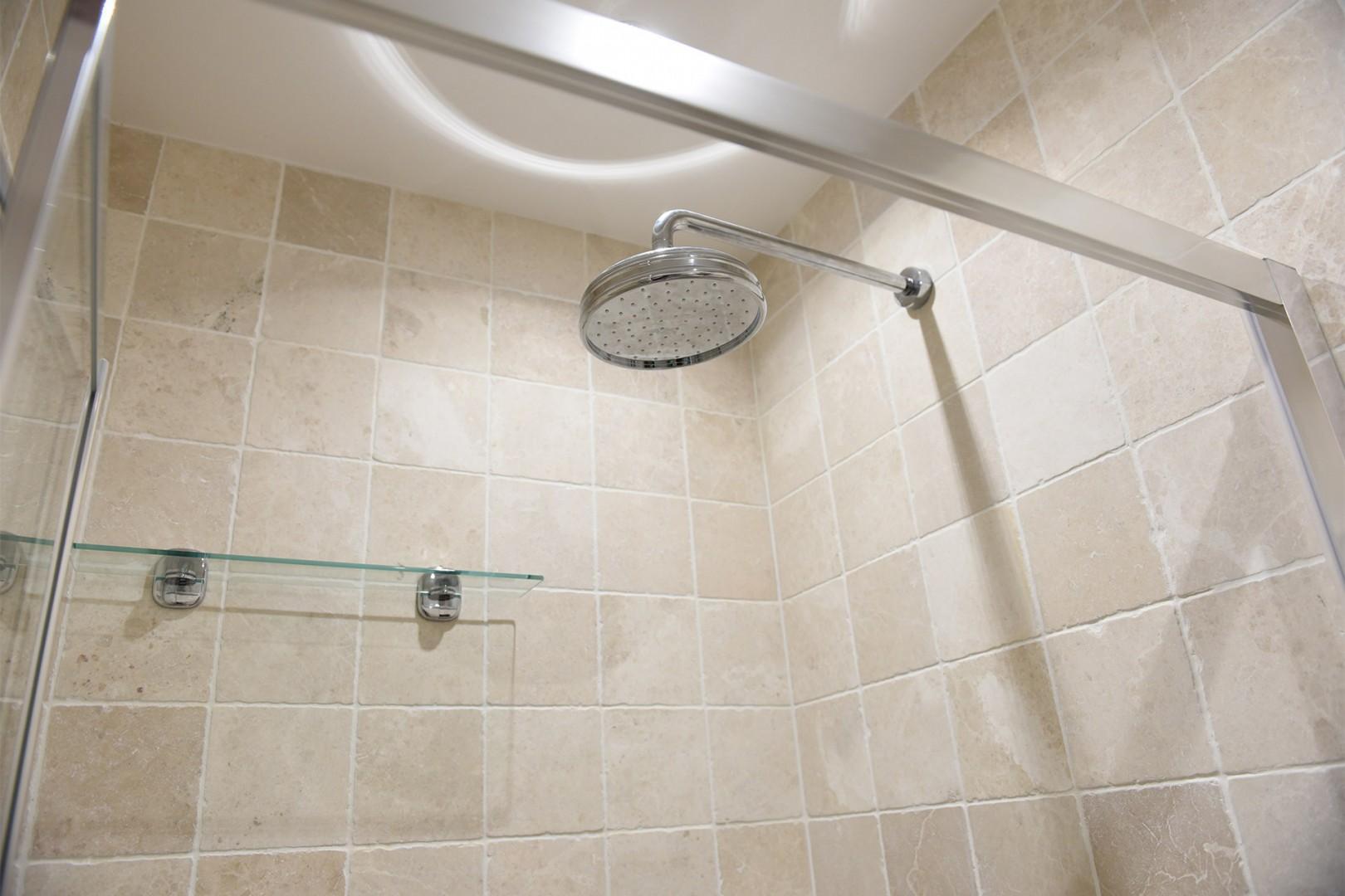 Bathroom 2 has a large shower.