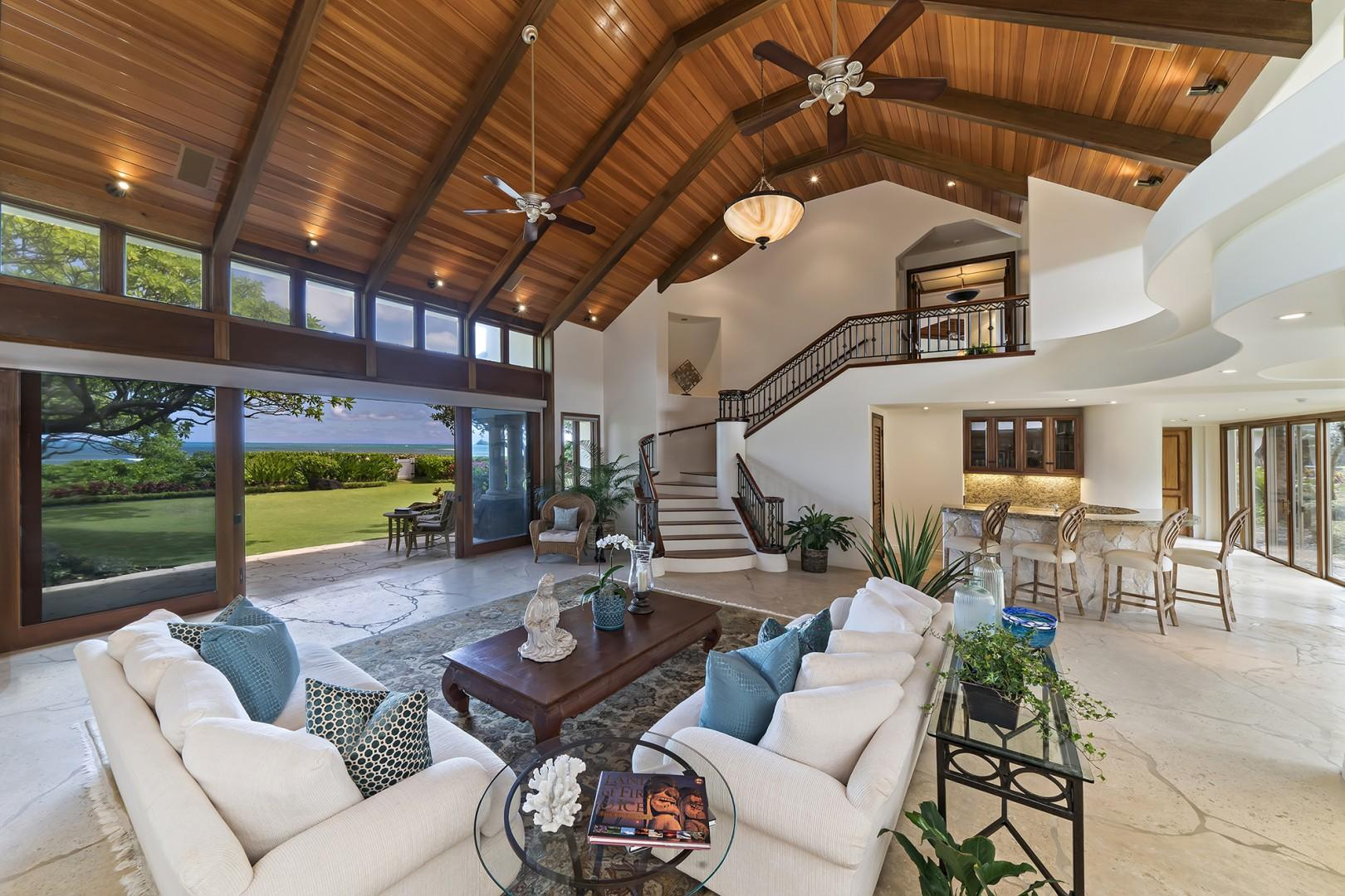 Main house: Main living room features breathtaking oceanfront views.  Follow the steps up towards the Master Bedroom.