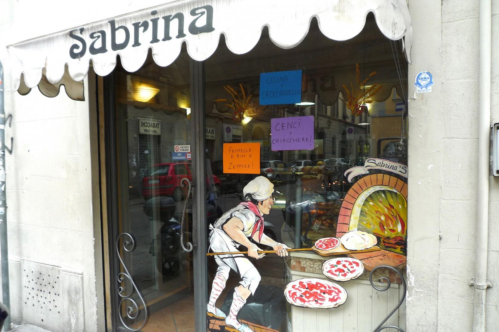The same bakery at the corner that sells pastries also has good pizza.