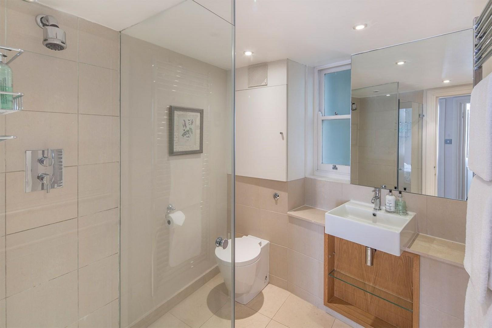 Second bathroom with shower, toilet and sink