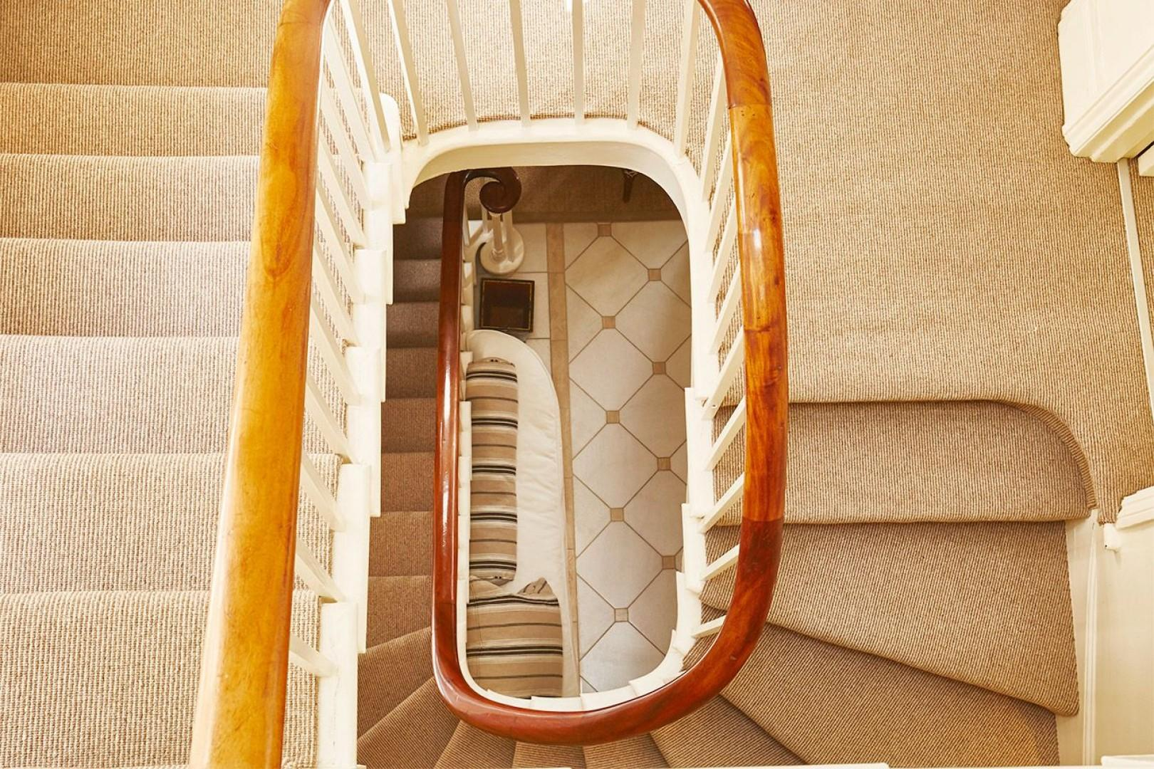 View down the open spiral of the staircase