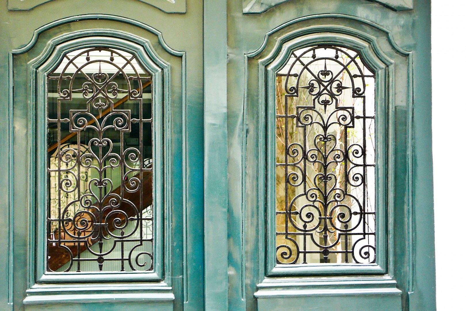 See the courtyard through the glass of these antique doors.
