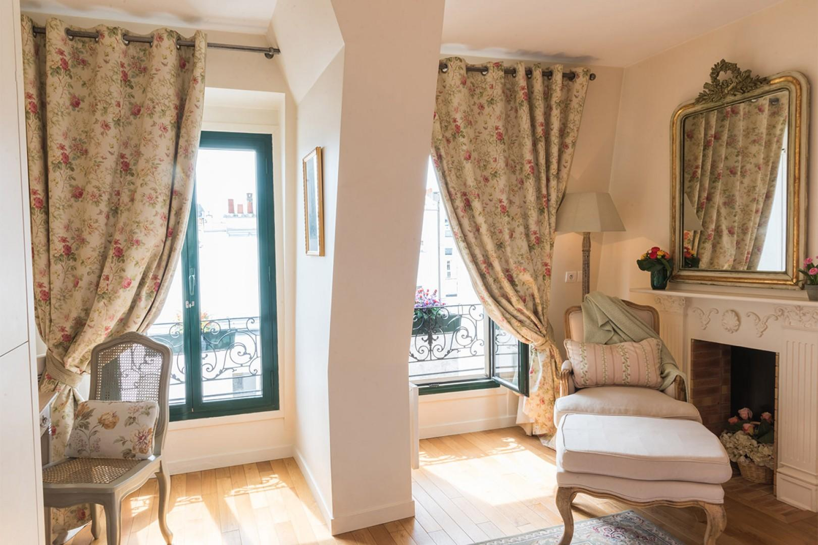 Large French windows in bedroom provide plenty of sunlight.