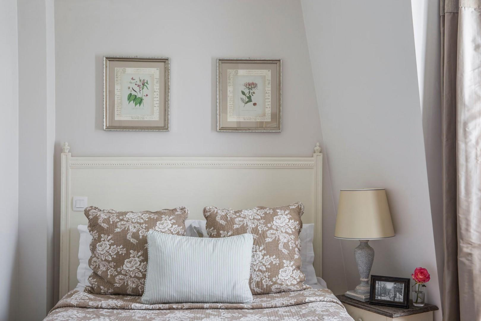 Bedroom 2 is tastefully decorated French-style.