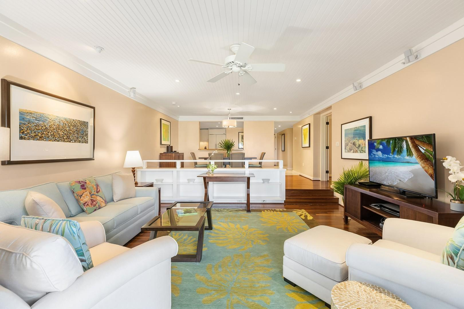 Dining area opens up into a large living space with comfortable seating.
