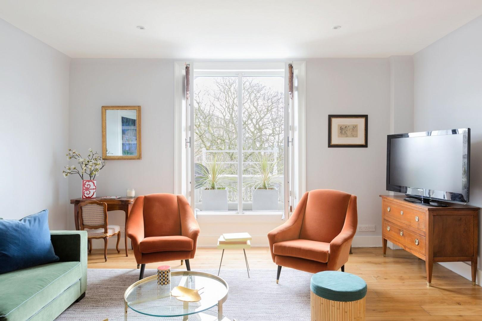 Natural light floods the living area from the large windows