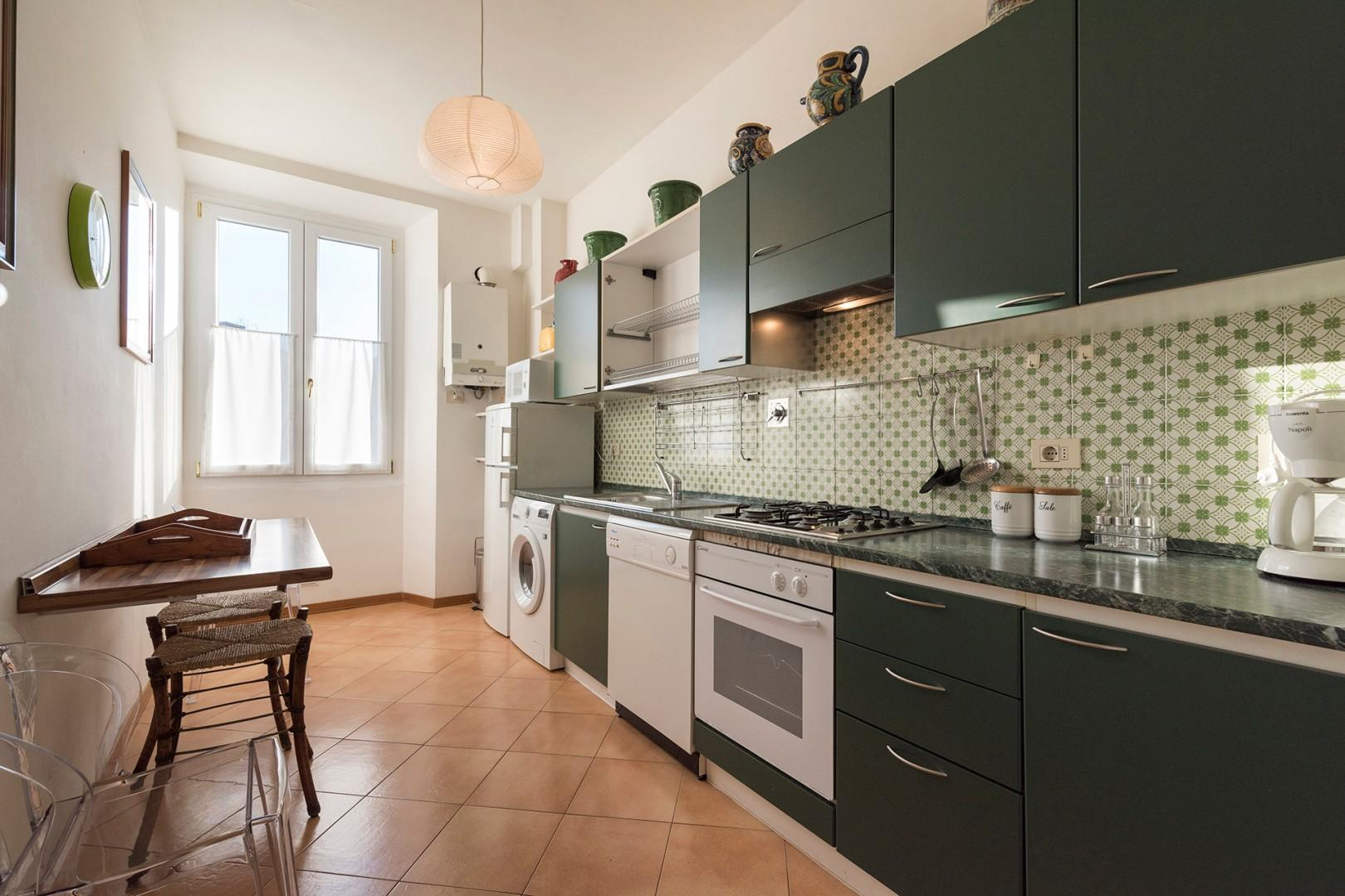 The kitchen is modern and of an adequate size for the apartment.