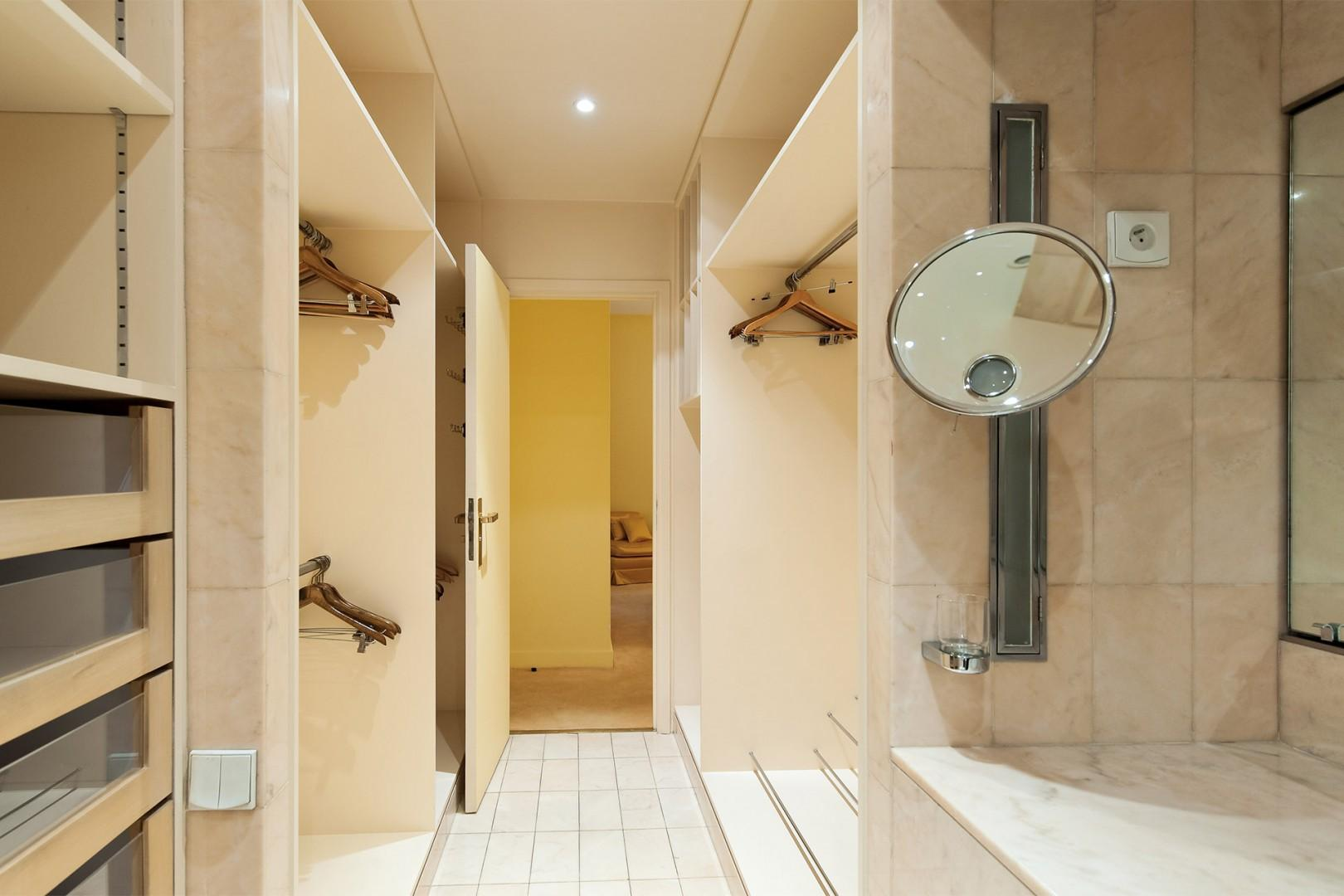 There is a convenient dressing room between bedroom 1 and bathroom 1.