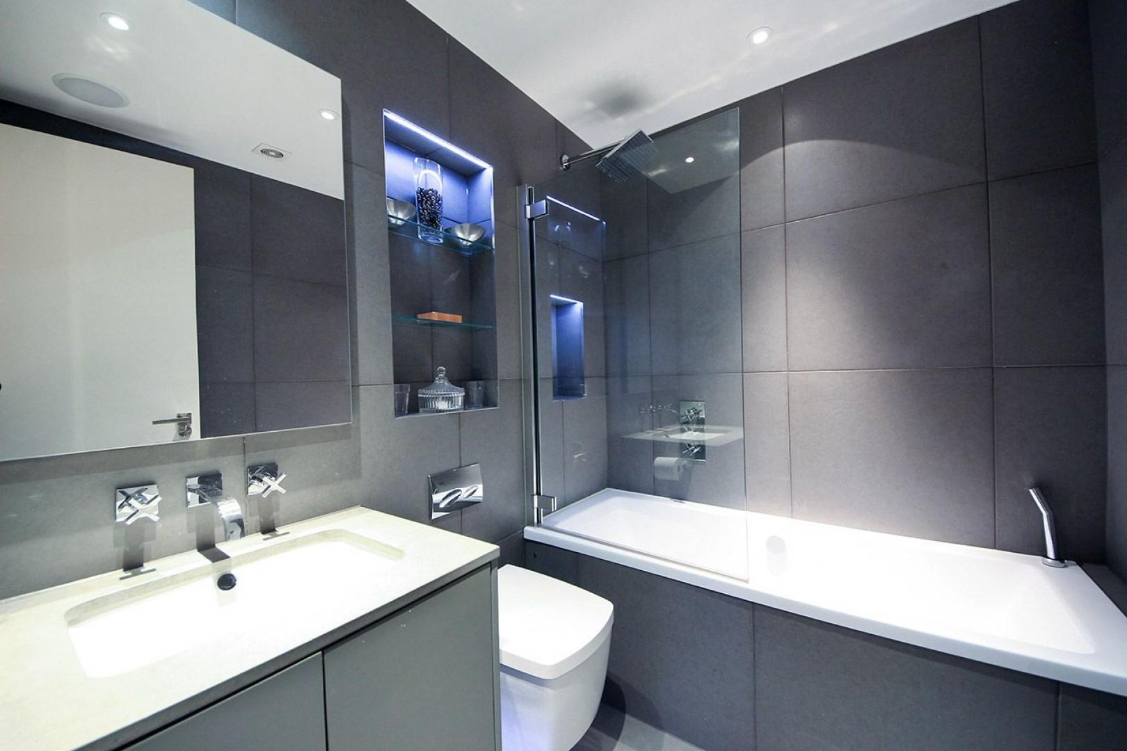 Second bathroom with bathtub-shower, sink and toilet