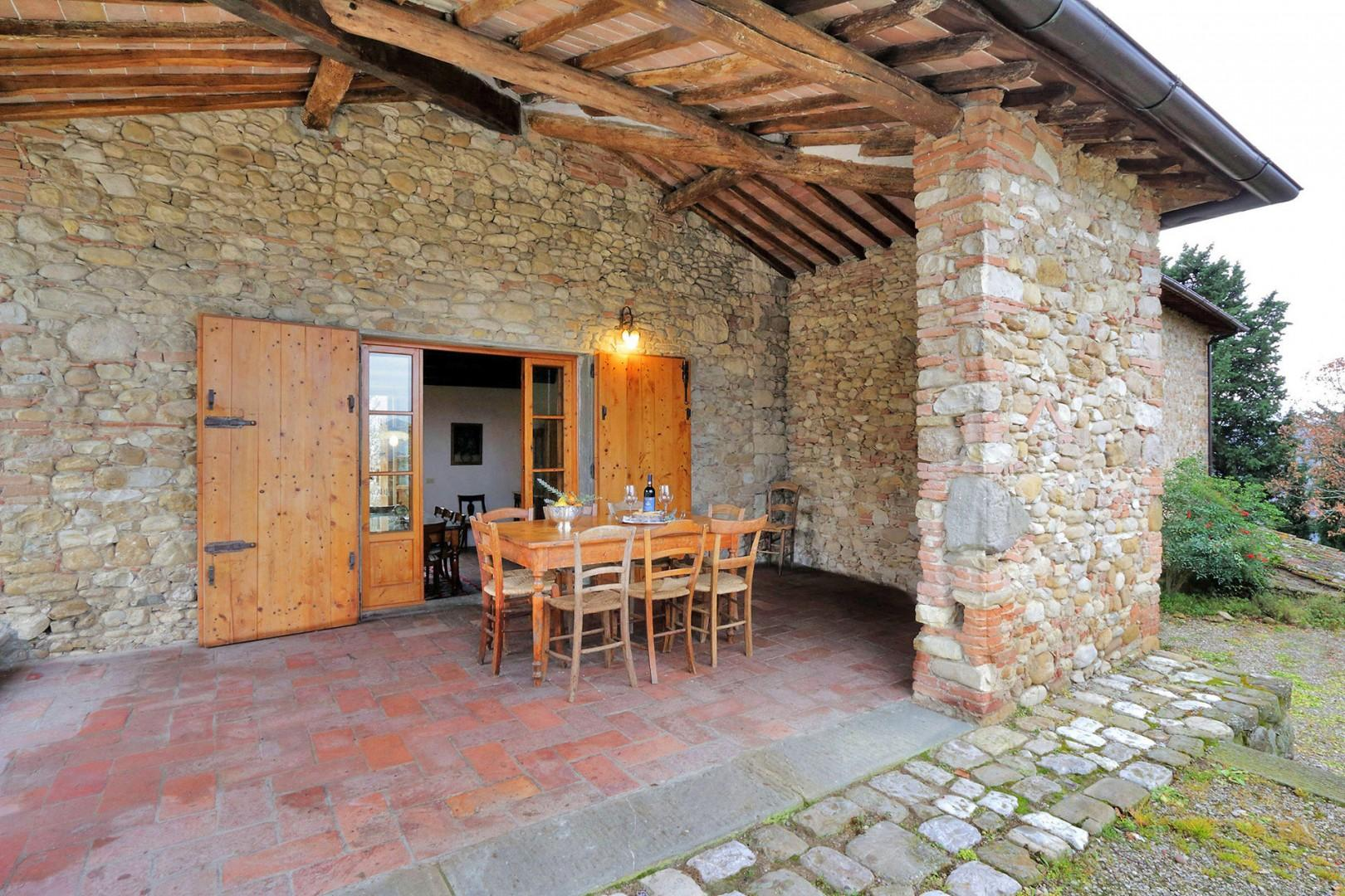 Outside the main level of the villa is a terrace or loggia perfect for dining al fresco.