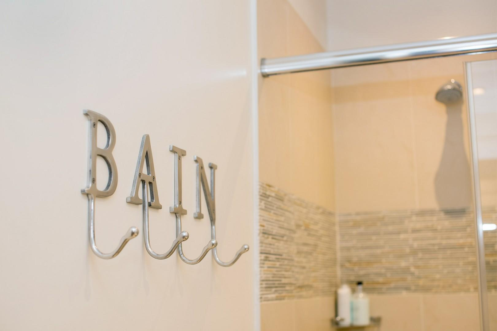 Stainless steel letters spell 'bathroom' in French!