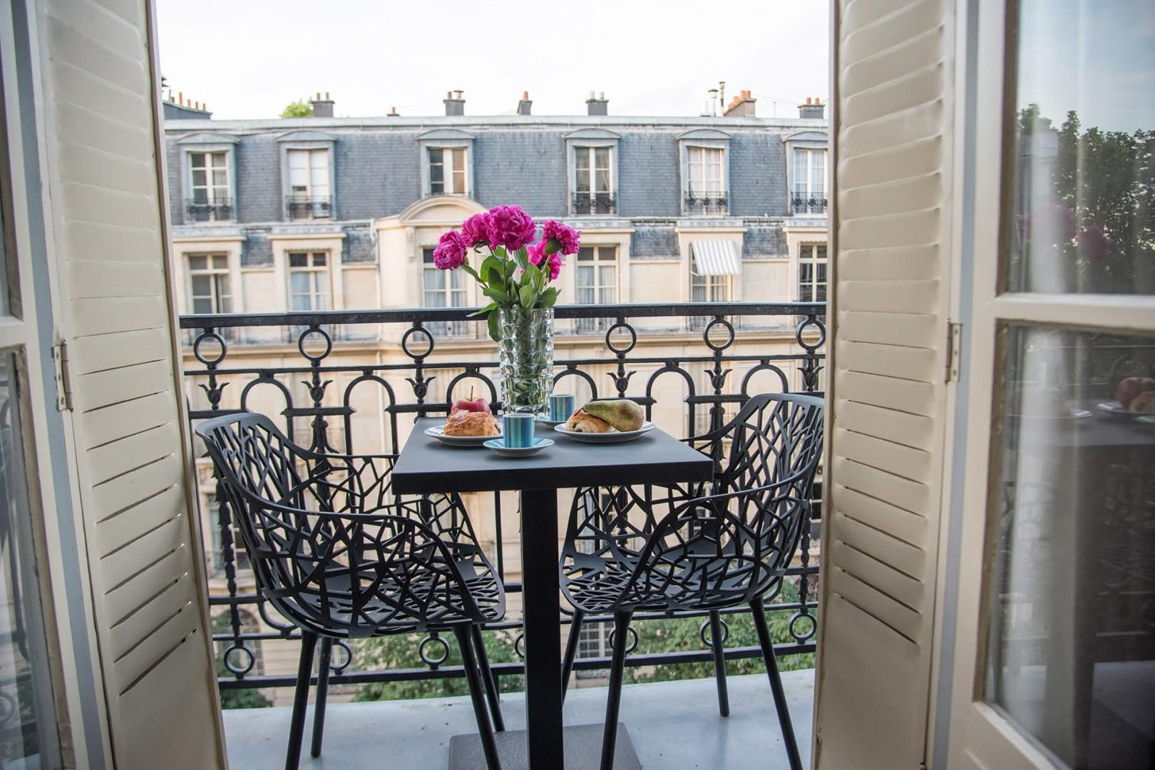 Soak in the Parisian atmosphere on your private balcony.
