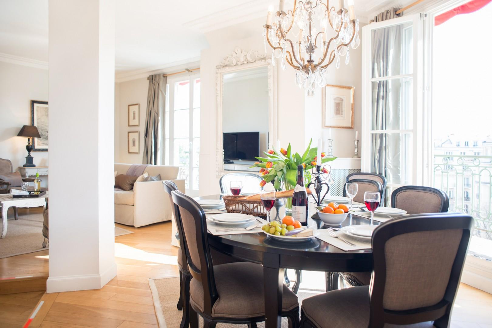The dining table near the French doors seats up to six guests.