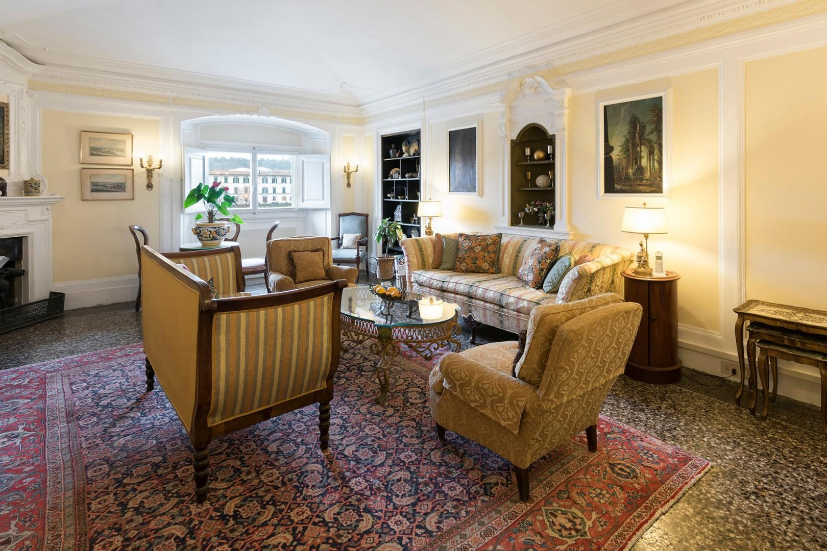 Plenty of seating in the large living room with views of the Arno River and Vespucci bridge.