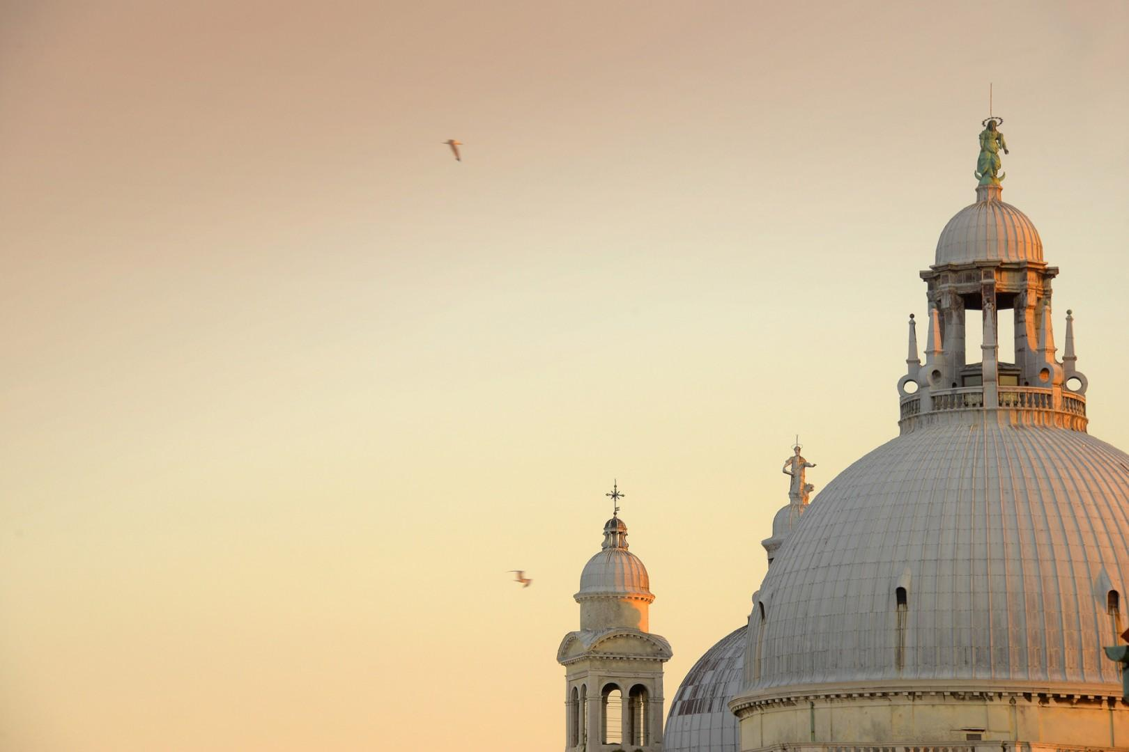 The cupola of Santa Maria Salute, across the grand canal peeks over the roof.