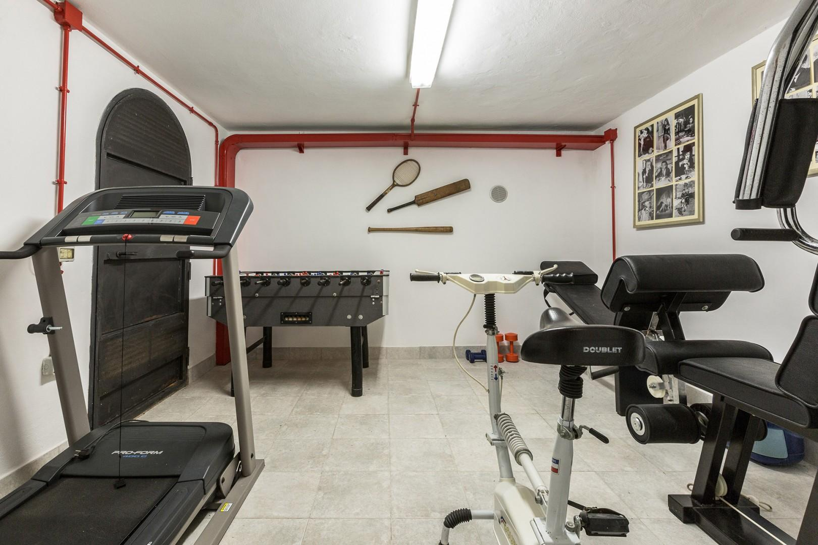 A mini gym is in the pool house located under the pool area.