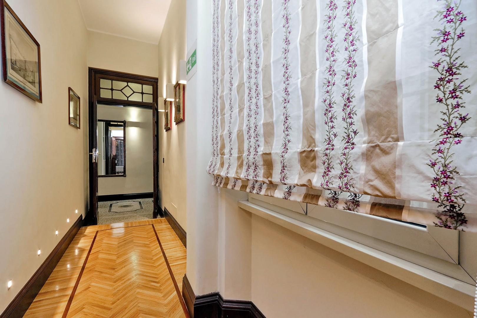 The hallways in this apartment are works of art themselves!