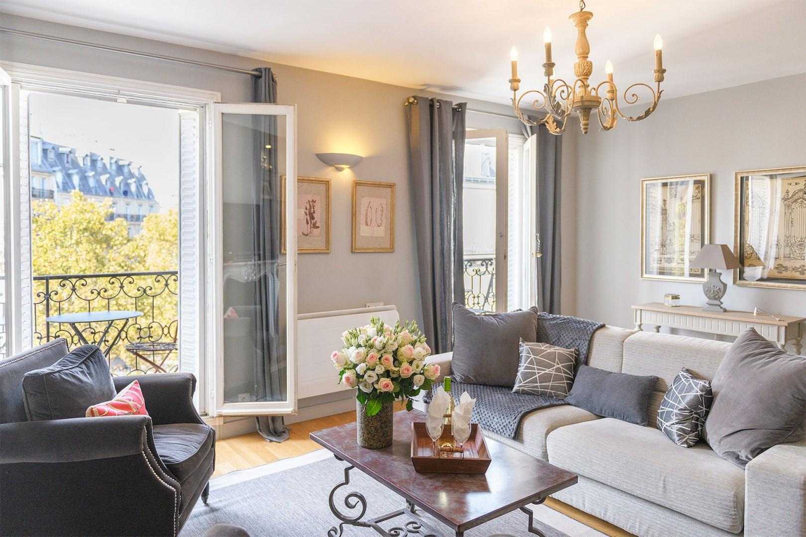 The spacious living room is perfect for celebrating your Paris vacation in comfort.
