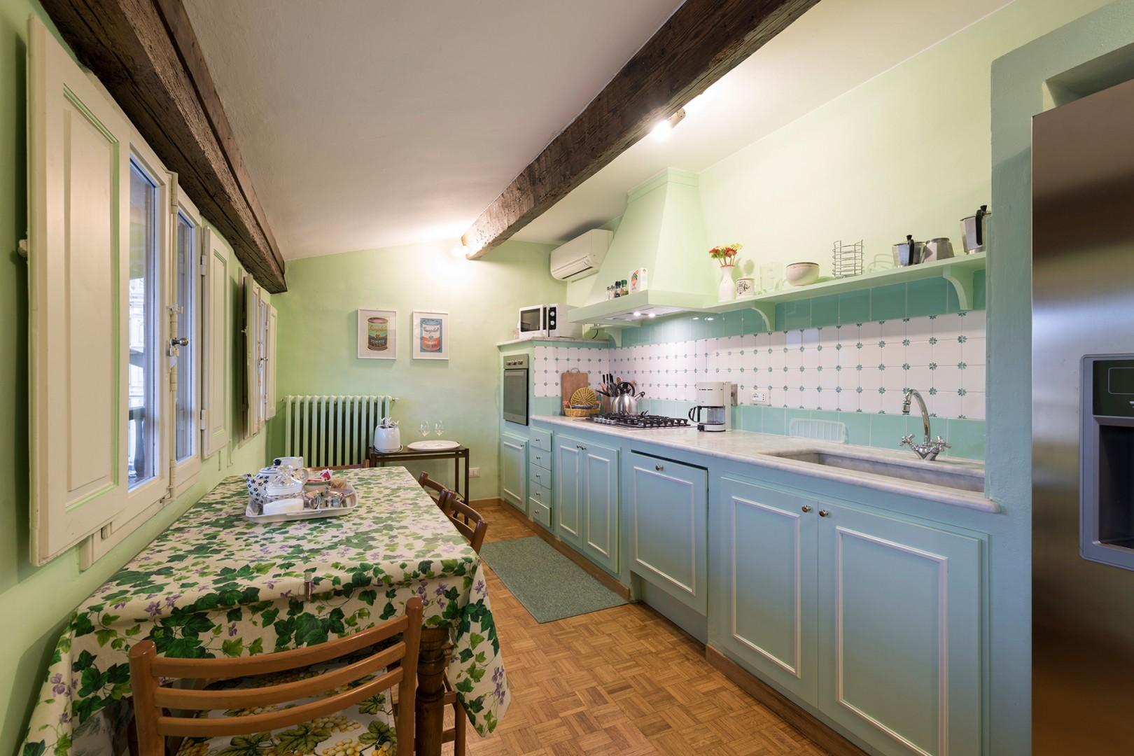 Kitchen has views of the piazza and of the Santa Croce basilica.