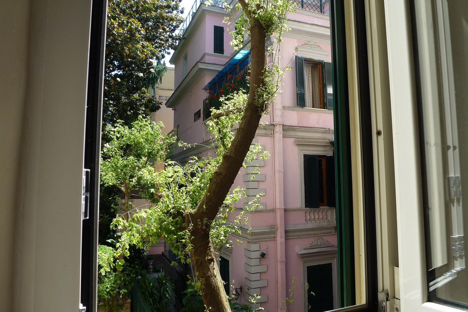 Nice views from bedroom 4 of an attractive pale pink Art Nouveau building just across the way.