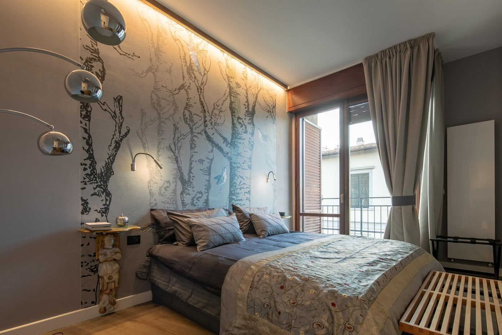 Elegantly decorated bedroom 1 with its own balcony and en suite bathroom.