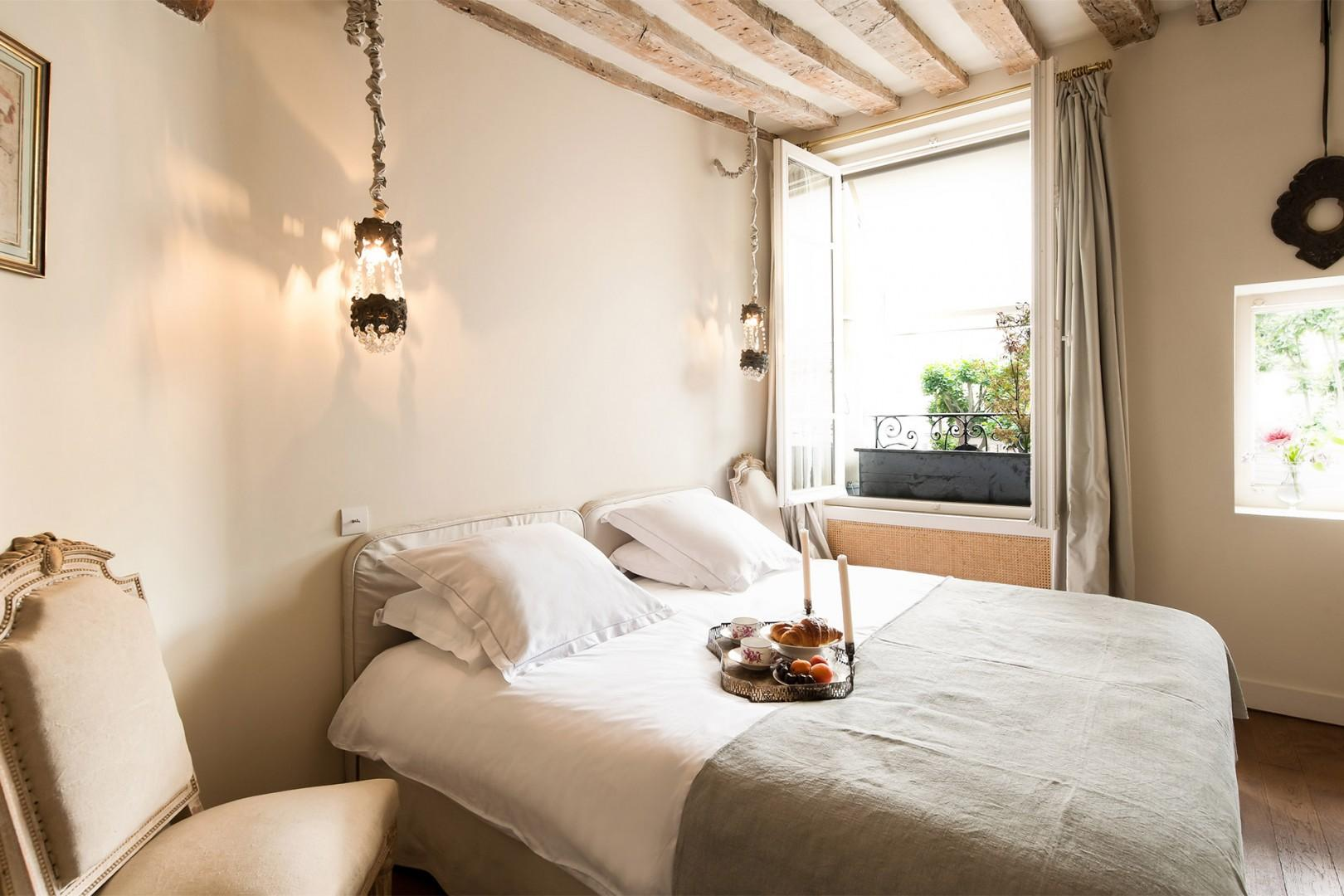 Relax in the cozy bedroom with a comfortable bed and bathroom.