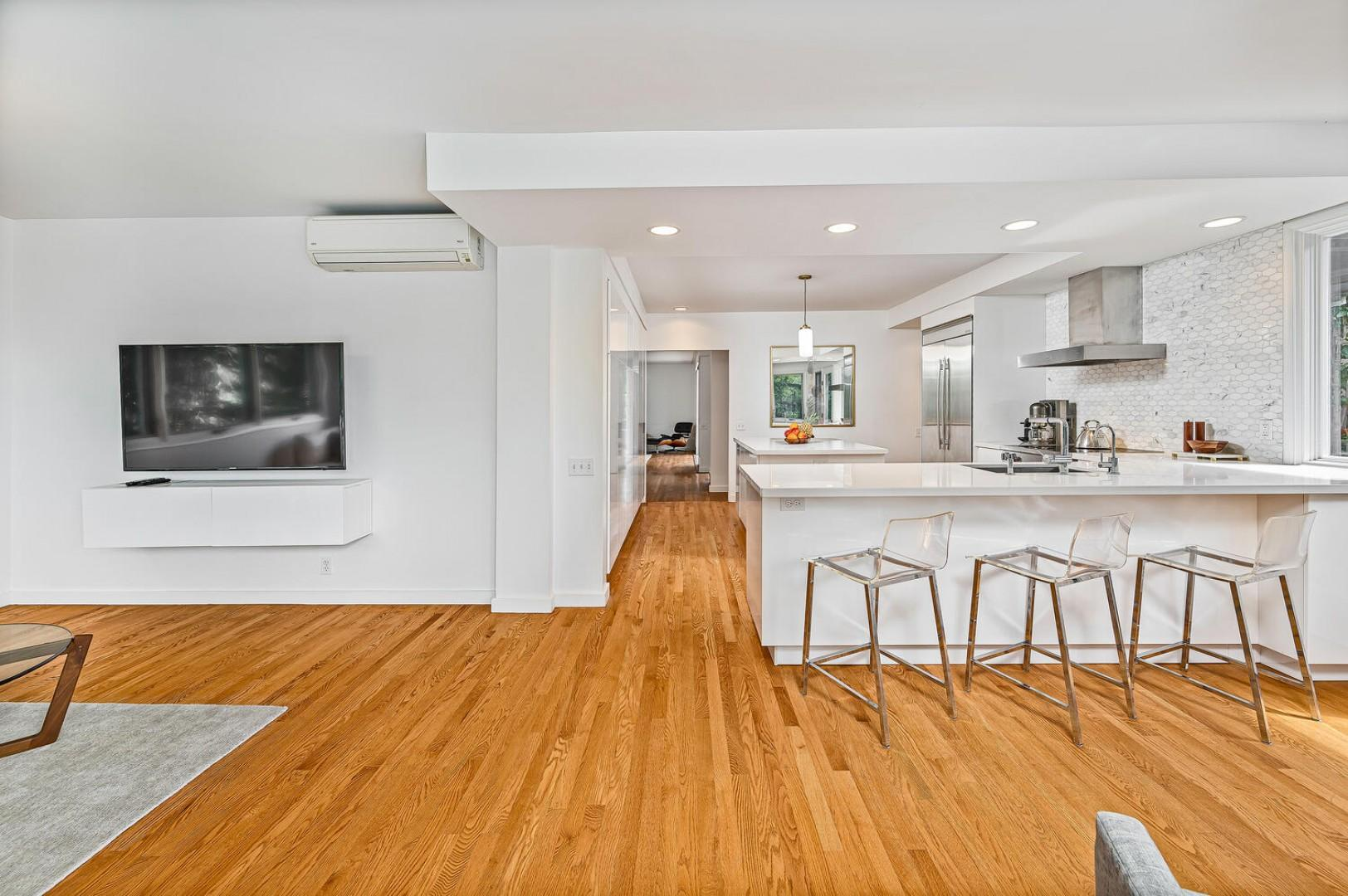 Kitchen and sitting area with smart TV