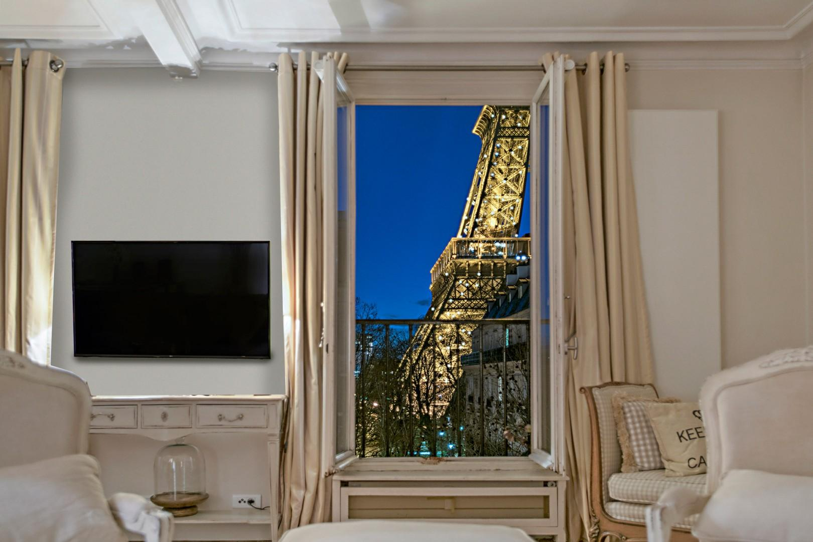 Watch the Eiffel Tower sparkle at night.