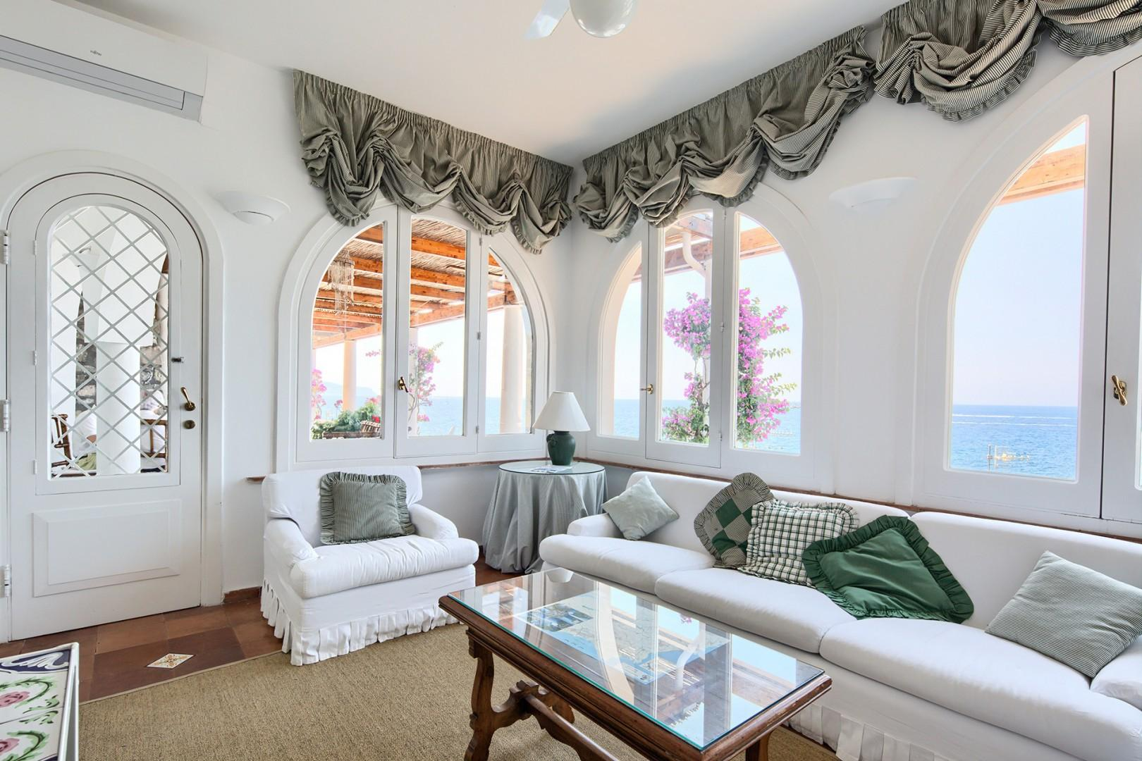 Cloudy white upholstery in living room overlooking the sea.