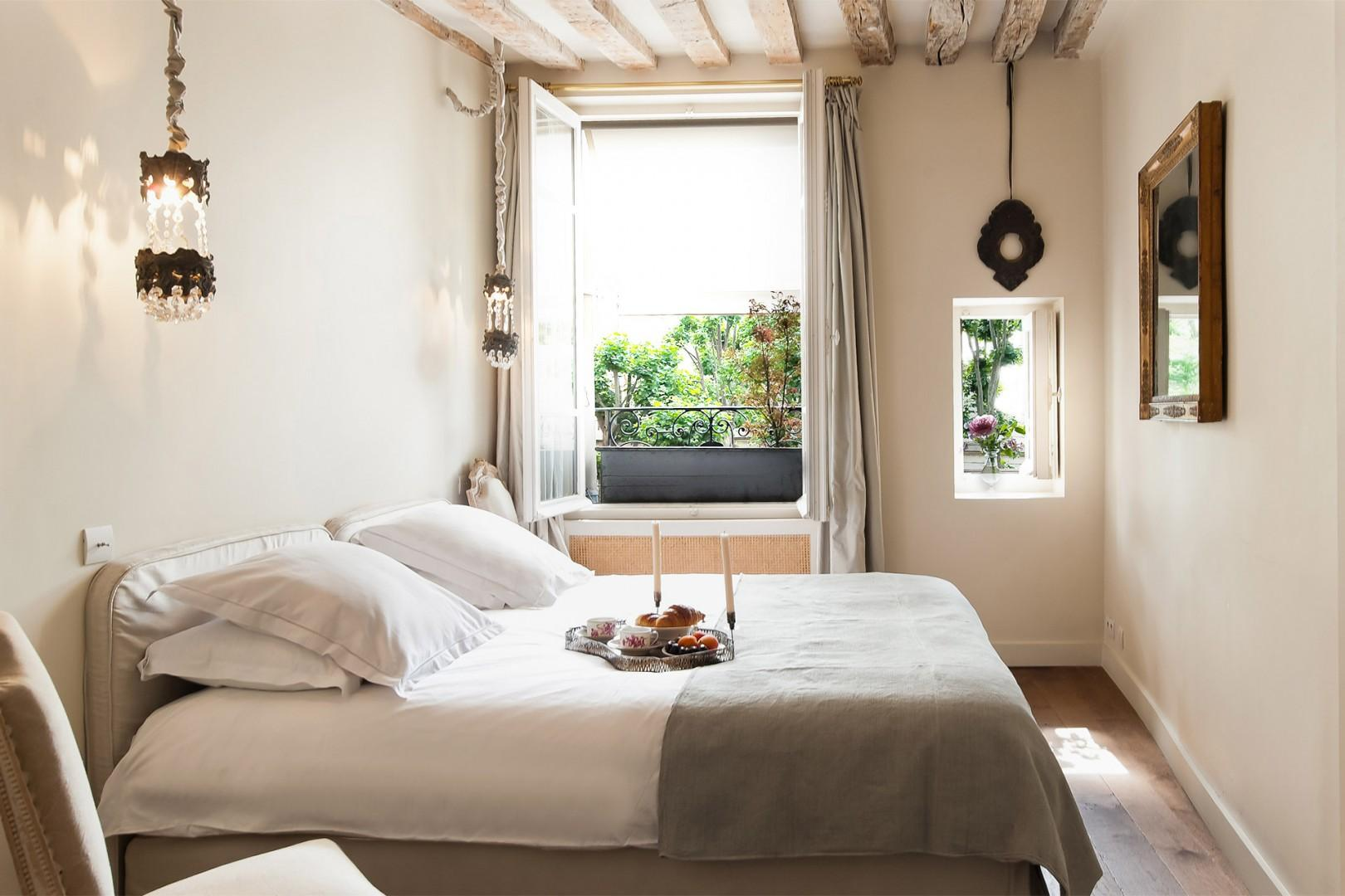 Two windows let lots of light into the bedroom.