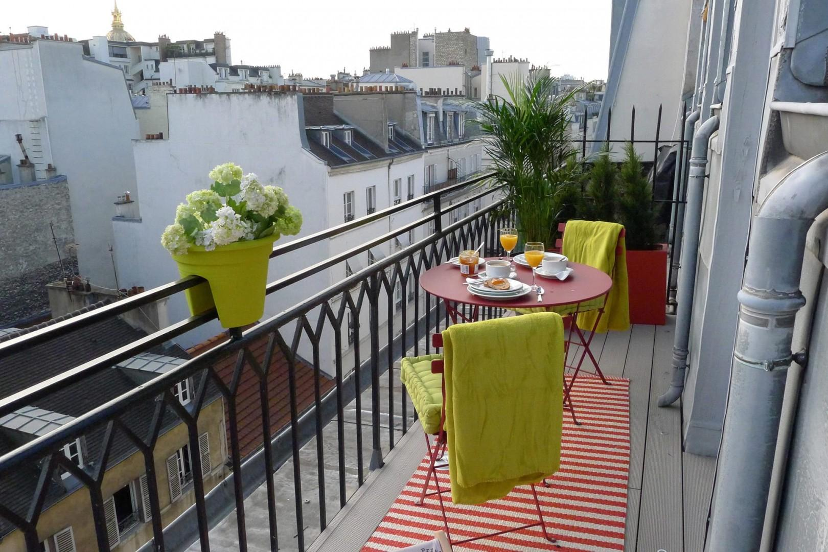 Sit outside on the sunny balcony of our Saumur apartment!